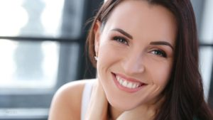 Smiling Model with White Healthy Teeth